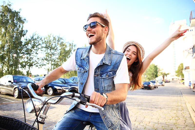 Young couple riding a bike together