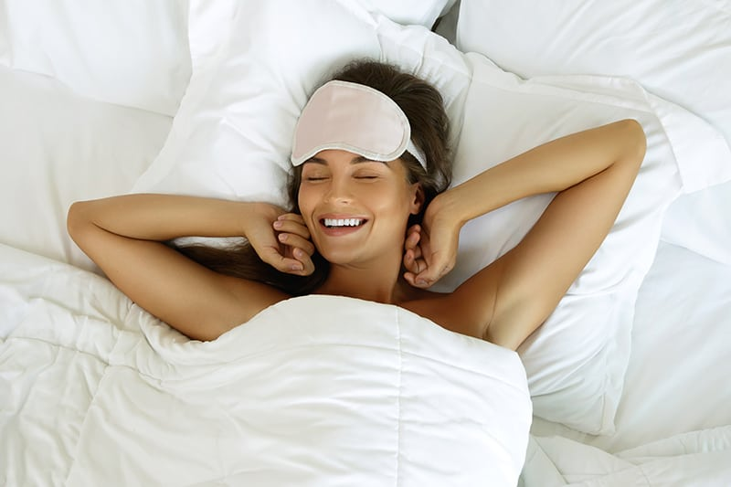 Young woman waking up well rested